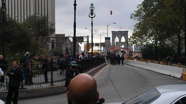 Police following after #OccupyWallStreet on the Brooklyn Bridge