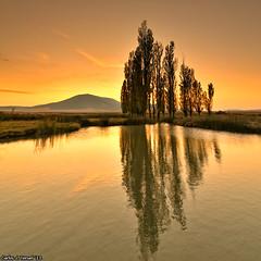 Reflejos dorados (Carlos J. Teruel) Tags: sunset españa sol atardecer nikon paisaje murcia nubes reflejo d300 caravaca 2011 tokina1116 xaviersam singhraynd3revgrad carlosjteruel