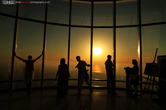 people At The Top (erickespinosa) Tags: sunset people tower silhouette creek rainbow dubai eid dhow emaar jebelali dubaimall burjkhalifa