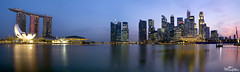 Singapore_City_Sundown_Pano_sig (Gareth Spiller) Tags: city sunset panorama water night canon reflections river singapore sundown dusk clam casino financialdistrict skydeck 1755 marinabay marinabaysands garethspiller
