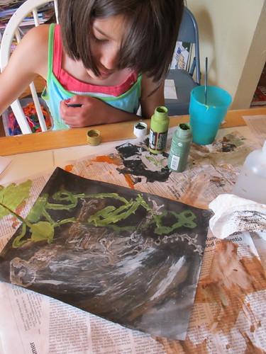 R working on her dino fossil glue resist