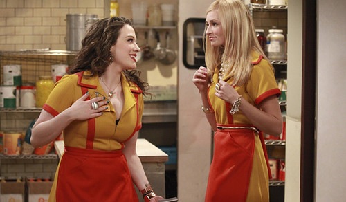 the stars of 2 Broke Girls wearing waitress uniforms