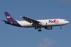 FedEx, Airbus A300, N749FD, at JFK, New York, USA. Sept 2011 (Tom Turner - SeaTeamImages / AirTeamImages) Tags: city nyc usa newyork plane airplane fly airport purple unitedstates aircraft aviation transport flight jet twin spot cargo jfk landing queens international final transportation airline airbus airways approach airlines fedex bigapple spotting airliner jetplane johnfkennedy portauthority fuselage a300 federalexpress airbusa300 tomturner n749fd