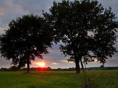 Glowing hole in the clouds (Teelicht) Tags: sunset germany landscape deutschland sonnenuntergang landschaft niedersachsen lowersaxony canonpowershots90
