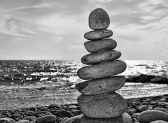 Pebble Stack (Raphooey) Tags: uk sea england sky cloud southwest west beach clouds surf waves angle south horizon shingle wave pebbles stack east pebble devon pile shore gb balance seashore slant balancing balanced sidmouth