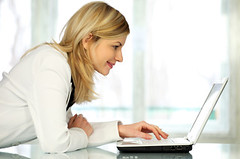 woman on laptop - iStockPhoto