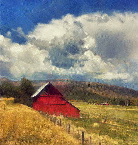 Red barn, fields and sky... Colorado roadside scene...