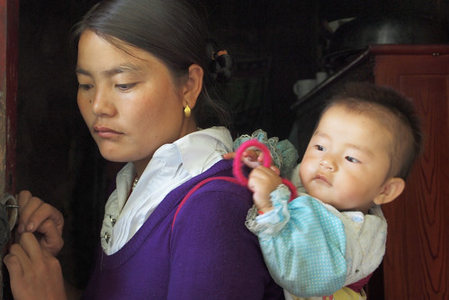 A woman and her baby in Tibet