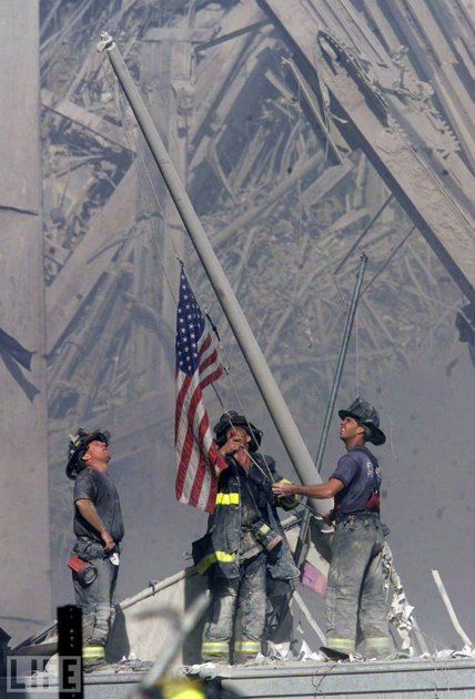 9/11 Firefighters raising flag