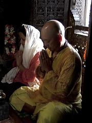 Puja (Dick Verton) Tags: travel flowers light people woman india man window asia sitting veiled praying sit varanasi seated puja nepalitemple