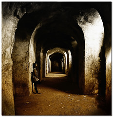 let the light guide you out of the dark dungeons of reality.. (PNike (Prashanth Naik..back after ages)) Tags: light shadow india building architecture dark ancient nikon asia darkness dungeon historic creepy reality hyderabad tombs qutb shahi qutub