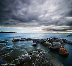 Storm Approaching (DanielKHC) Tags: sea seascape storm water clouds digital finland landscape boat helsinki nikon rocks long exposure smooth fortress dri suomenlinna blending d300 nd400 danielcheong danielkhc tokina1116mmf28