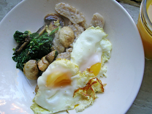 fried eggs and oatmeal with spinach and mushrooms
