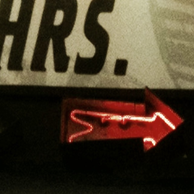Red neon arrow #walkingtoworktoday