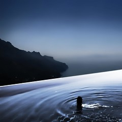 Infinity (CoolorFoto) Tags: sea sky cliff mountain water pool haze mood infinity dream surreal atmosphere swimmer mountainside bluehour infinitypool