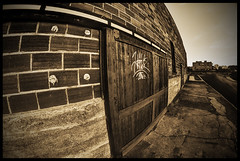 Graffiti (BHagen) Tags: old sky blackandwhite bw building brick abandoned blancoynegro broken sepia architecture graffiti blackwhite washington nikon spokane grunge border gritty fisheye worn destroyed spokanewa d90 prooptic