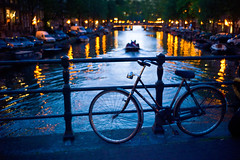 Blue (Sator Arepo) Tags: leica bridge blue urban orange holland reflection water netherlands ecology amsterdam bike bicycle night 35mm evening boat canal europe wake rangefinder sail bluehour lowkey eco summilux m9 preasph leicam9 retofez120605