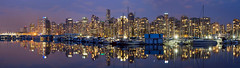 Vancouver BC Downtown Panorama at Dusk (David Gn Photography) Tags: city blue panorama canada reflection skyline night vancouver marina buildings landscape boats raw cityscape bc waterfront view skyscrapers sundown dusk britishcolumbia scenic property scene hour highrise stanleypark yachts sailboats condos canadaplace stitched coalharbour condominiums photomerged canoneos7d sigma2470mmf28ifexdghsm sigma50th