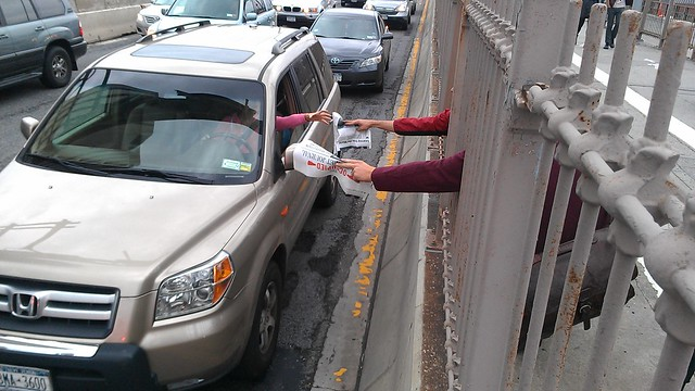 Handing out #OccupyWallStreet Journals to drivers on the Brooklyn Bridge