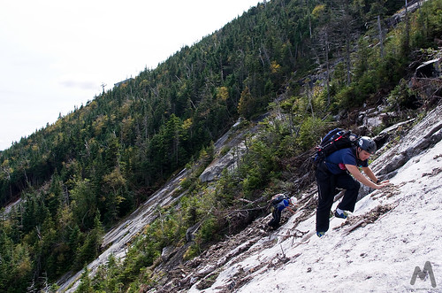 Ascending the lower slabs of Whiteface Ski Slide #3