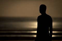 Looking. Crosby. Explored. (Ianmoran1970) Tags: sunset man beach water dark sand focus ironman explore crosby anthonygormley anotherplace ironmen explored ianmoran ianmoran1970