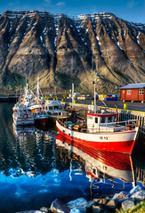Boat in Isafjordur (Stuck in Customs) Tags: world travel red sky mountain cold west water june digital island photography pier boat town iceland blog high fishing dock europe village dynamic stuck northwest bright little glacier photoblog software edge transportation processing boating fjord imaging peninsula range hdr height tutorial trey fjords sland travelblog customs westfjords fishery crag northatlantic safjrur eyri 2011 midatlanticridge ratcliff hdrtutorial stuckincustoms skutulsfjrur treyratcliff photographyblog stuckincustomscom safjararbr tjruhsi vestfiroir isafjorour nikond3s tjoruhusio
