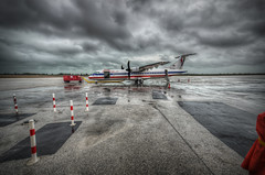 Waiting for Passengers (Noah J Katz) Tags: sky black wet water rain tarmac clouds plane airplane grey moody cloudy stormy passengers american passenger poles bahamas