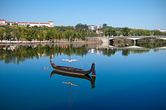 On stranger tides (Rui Nuns) Tags: bridge reflection portugal rio river boat rustic vessel reflexo mondego barcaserrana ruinunes