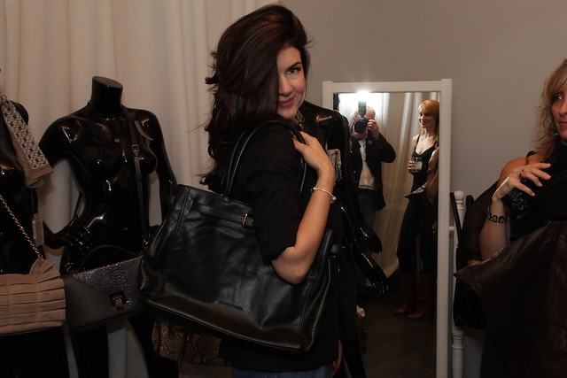 Gabrielle Miller tries on a Coccinelle bag
