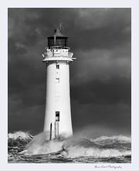 'Storm...'  (Perch Rock 6) (Brian Gort Wildlife Photography) Tags: uk sea blackandwhite bw lighthouse storm rock mono nikon wave perch nikkor wirral d90 flickraward nikonflickraward flickraward5 flickrawardgallery