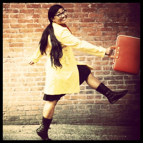 Prancing in my yellow coat and red briefcase
