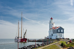 Marken 2011 (kruijffjes) Tags: old city travel blue wallpaper sky lighthouse white house holiday holland color tree green tourism church nature netherlands beautiful dutch grass sunshine weather landscape happy one scenery colorful europe day village background small scenic nederland tourist only concept gdk conceptual picturesque vuurtoren marken touristic paardvanmarken d7000 gdk nikond7000nikon pwpartlycloudy