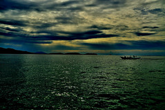 Anilao (Luke Arcellana) Tags: sea sun water set island boat philippines luke arcellana anilao batangas coulds mabini lukearcellana