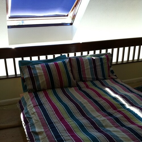 Sunny bed with clean sheets