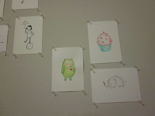 Drawings pinned to the gallery wall.