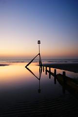 Breakwater at sunrise. (sidibousaid60) Tags: uk sea england sky reflection sunrise serenity isleofwight serene breakwater sandown