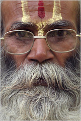 sadhu, hampi (nevil zaveri) Tags: travel portrait people india man eye tourism face look closeup beard religious photography glasses blog eyes photographer faces photos details religion stock images photographs photograph cropped karnataka zaveri gaze tika sadhu hampi stockimages travelogue nevil vijaynagar nevilzaveri