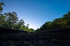 Stars and Bars (jon_beard) Tags: railroad trees sky night train stars tracks rails