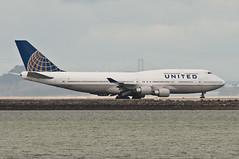 United 747 taxis at San Francisco (SBGrad) Tags: sanfrancisco airport nikon sfo boeing nikkor 747 unitedairlines 747400 ksfo alr staralliance 2011 d90 tc17eii 300mmf28dii n128ua