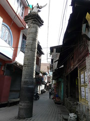 Garud pillar in front of complex gateway