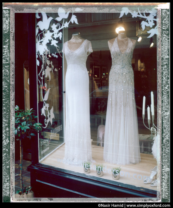 Elegant dresses in shop window