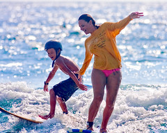 Sunday @ Pines (konaboy) Tags: ocean boy woman sun beach water sport fun hawaii surf play surfer mother smiles son surfing malia laughter bigisland pinetrees kona ake wahine kohanaiki img0591f