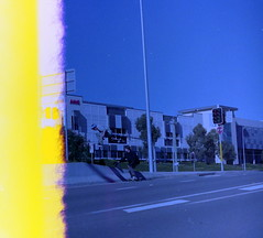 First Frame, First Try (brendannnnnnnnnn) Tags: blue light orange film youth photo kodak 10 sydney first olympus 400 skate frame 1989 om leak expired destroyed ruined kicker kickflip norwest parklea
