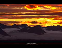 Sunset over the glacier (Hkon Kjllmoen, Norway) Tags: sunset isfjorden svalbard longyearbyen cold colorful red glacier white nightshot beautiful hkonkjllmonen wwwkjollmoencom canon600mm norway natureselegantshots abigfave diamondclassphotographer lickraward flickraward supershot flickrdiamond coth5 impressedbeauty naturesfinest hkonkjllmoen