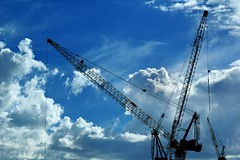 blue sky construction (mugley) Tags: blue sky clouds digital skyscape construction nikon industrial d70 zoom silhouettes australia melbourne victoria cranes telephoto tele docklands machines nikkor dslr f8 cloudporn towercranes rigging jigs urbanlandscape booms collinsst 70210mmf456d cloudage 12500s 92mm batmanshill gsub axasite