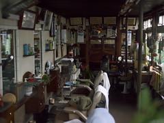 The inside of the window (tetsuo5) Tags: kyoto 京都 barbers 大雨 理髪店 sonobe 南丹市 園部 nanntann dmcg2 dgsummilux25mmf14 窓越し撮影 傘差し片手撮影 バンザイ撮影
