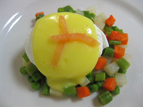 Poached Eggs on Macedoine Vegetables with Hollandaise