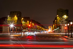 Avenue des Champs-Elyses - Paris (romvi) Tags: city longexposure trees horse trafficlights paris france bus cars monument night de cheval lights nikon europe cityscape nacht f14 perspective arc triomphe trails 85mm icon des arbres villa semaforo lighttrails avenue nuit arcdetriomphe romain sculptures notte champselyses ville voitures fil lumire feurouge samyang avenuedeschampselyses longuepause d700 romainvilla romvi samyang85mmf14