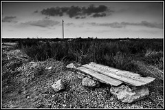 In the middle of Nowhere (Dev EBM) Tags: summer sky bw espaa white lake holiday black nature clouds canon bench eos spain rocks salt salinas alicante sal torrevieja costablanca alacant comunidadvalenciana salinasdetorrevieja 60d efs1585isusm