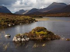 Loch Gleann na Muice (vathiman) Tags: mountains clouds reeds scotland highlands heather loch